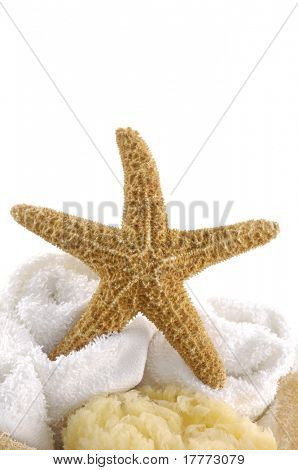 Assorted towels and starfish on white background