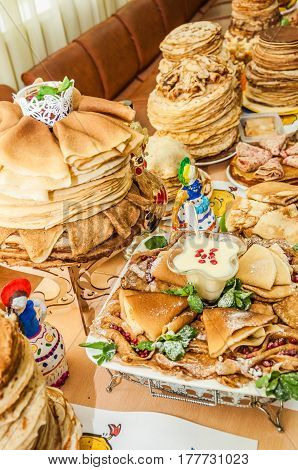 A variety of original pancakes in the contest during the celebration Russian Shrovetide (pancake week) at school
