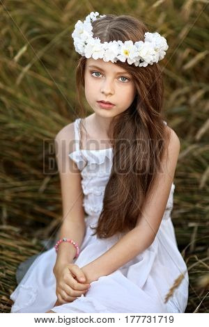 Portrait Of A Beautiful Little Girl In A Field