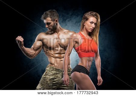 Athletic Man And Woman. Fitness Couple.