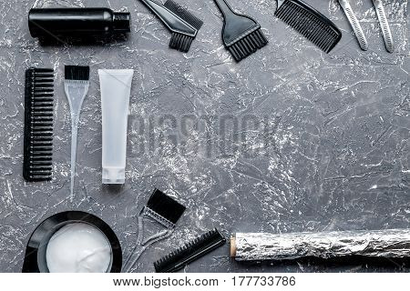 hairdresser working desk with tools for dye hair on gray table background top view mock up