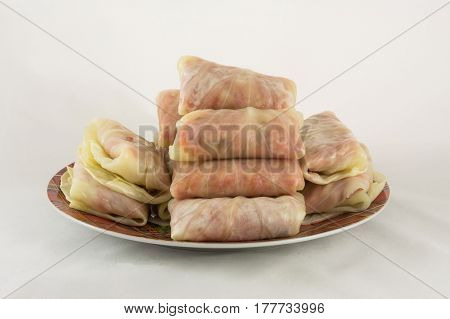 Food stuffed on plate white background cooking recipe subject shooting still life cabbage beef meat home-made food group many