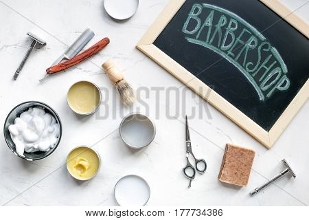 barbershop for men with tools for shaving on white table background top view