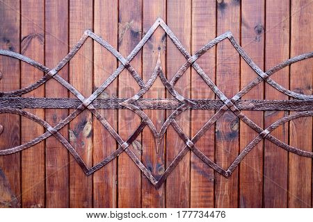 Detail handmade wrought ornaments on the wooden door
