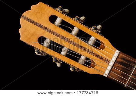 Close up on a classic guitar made of wood,  vintage guitar