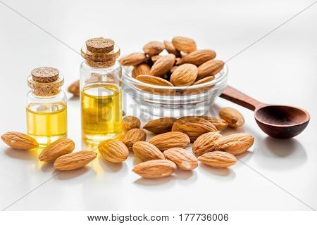 organic cosmetic set with almond extract in bottle on white table background