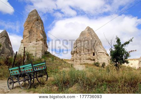 Travel To Goreme, Cappadocia, Turkey. The View On The Valley In The Mountains With A Cart On The For