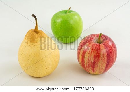 fruit pear yellow and two apple red green white background on the table subject shooting group many afternoon