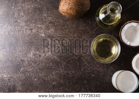 Spa treatments and massages. Coconut and coconut oil for spa on a dark marble background. Exotic large walnut. Personal care. Spa treatments. Spa concept