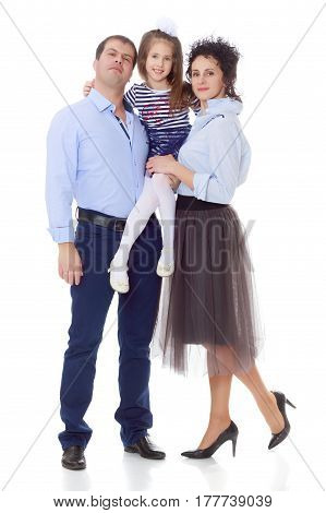 Happy young family, mom dad and little daughter.Parents keep the girl in her arms , and she hugs their neck.Isolated on white background.