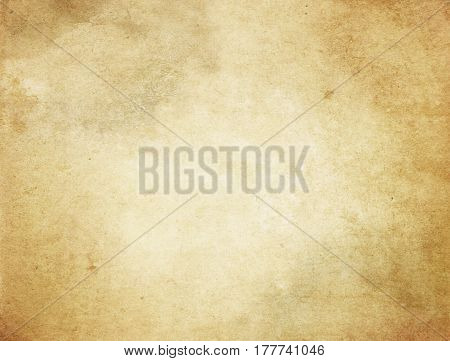 Aged yellowed paper background. Grunge paper for the design.