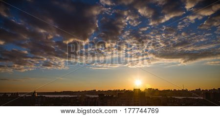 Aerial panoramic ramatic view from rooftop of cityscape in sunset time with clouds on sky, Voronezh city, copyspace