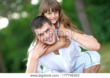 Portrait Of A Happy Family In Summer Nature