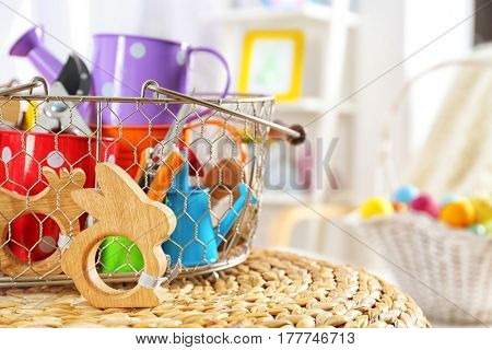Easter composition with horticultural sundries on wicker surface