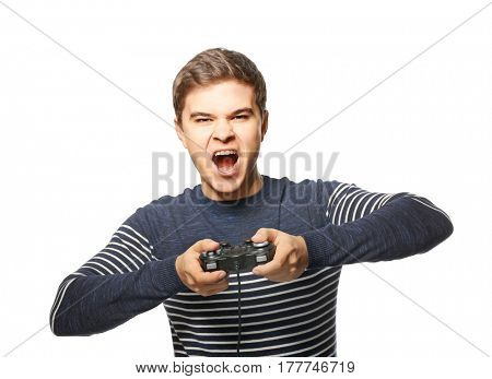 Teenager playing videogame on white background
