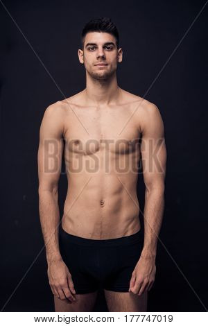 One Young Man Shirtless Underwear, Looking At Camera
