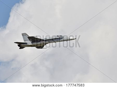 Modern US Navy fighter jet against the clouds