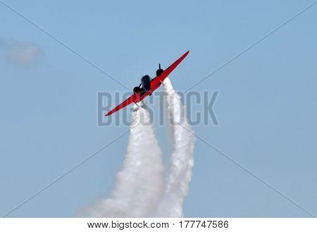 Retro propeller airplane soaring into the sky