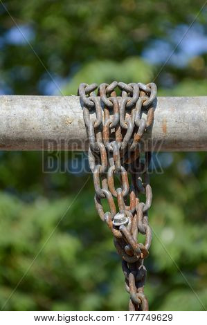 close up old chain on iron pole