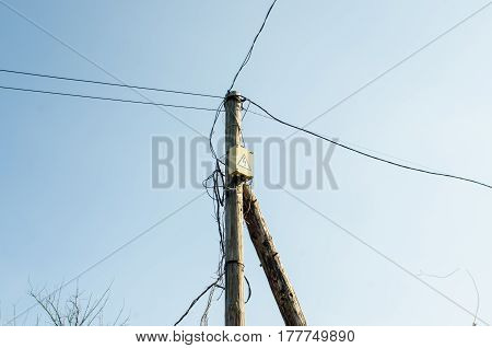 old wooden electric pole gainst the sky.