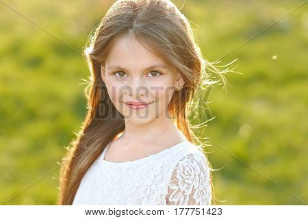 Portrait Of A Beautiful Little Girl In Spring