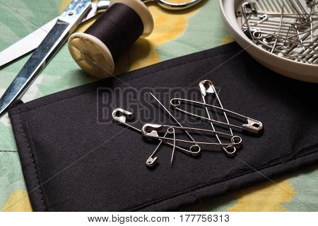 safety pins and scissors reels in the morning