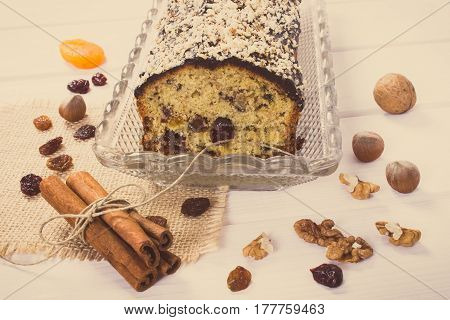 Vintage photo Fresh baked homemade fruitcake and ingredients for baking on boards delicious dessert