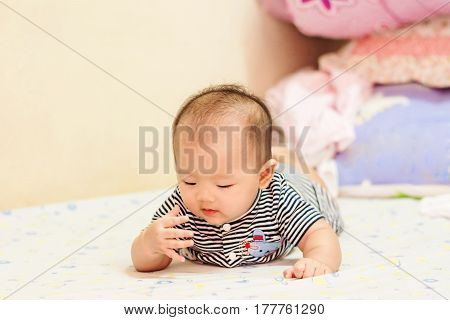 Asian Baby Lie Prone On Bed