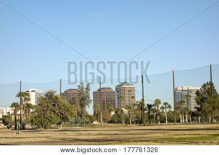 Golf course white balls spread all over grass in Encanto par Phoenix downtown Arizona in Winter.