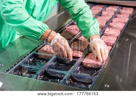 Several chunks of raw meat being processed packaged and shipped