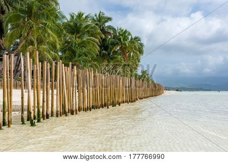 Barrier Made Of Bamboo Poles In A Tropical Island