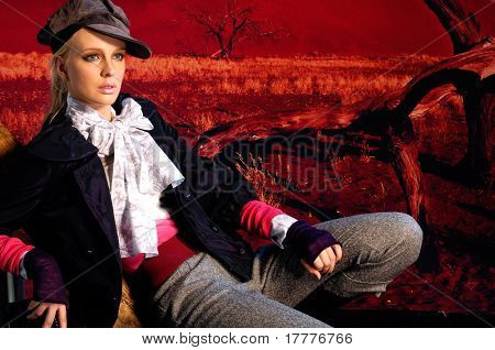 Fashion model in autumn/winter clothes posing on location Namibia, Africa