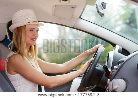 Transportation and vehicle concept. Woman driving car with hand on horn button female driver honking in traffic