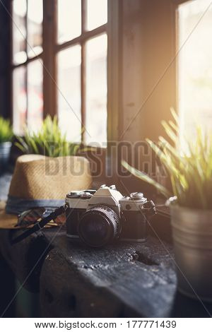 Retro camera with hat and soft light, Travel concept