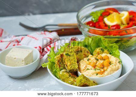 Vegan lunch: falafel tofu salad and hummus. Love for a healthy vegan food concept