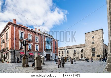 Avila Spain - November 11 2014: People in the square in front of the Cathedral of Avila. The old city and its extramural churches were declared a World Heritage site by UNESCO
