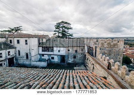 Avila Spain - November 11 2014: The Medieval Walls of Avila. The old city of and its extramural churches were declared a World Heritage site by UNESCO