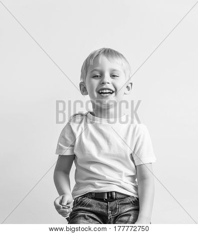 happy cheerful little boy playing laughing making a face on white background soft focus