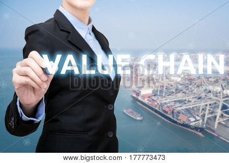 Smart Business Woman Is Writing Value Chain Concept With Shipping Boat At Shipping Yard In Backgroun