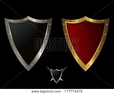 Golden and silver medieval shields with riveted borders. Isolated object on black background.