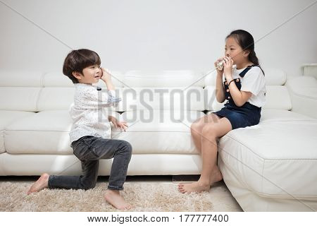 Asian Chinese Little Brother And Sister Playing Tin Can Phone