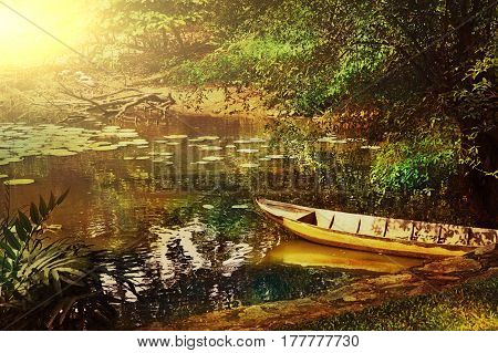 Picturesque Scene With Yellow Boat On Water Lily Pond