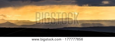 Colorful sunlight sunset over the mountains. Amazing view of the landscape in Iceland.