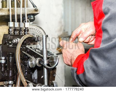 Professional Mechanics Testing Diesel Injector In His Workshop, Repair Of Diesel Fuel Injectors, Ust