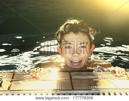 Teenager Boys In Open Air Swimming Pool