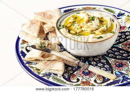Classic Hummus With Herbs, Olive Oil In A Vintage Ceramic Bowl A