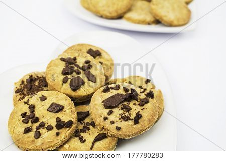 A plate of Gluten free Organic Homemade Chocolate Chip Cookies with more Cookies in the background