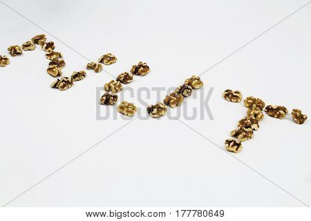 Walnuts shaped to spell the word NUT