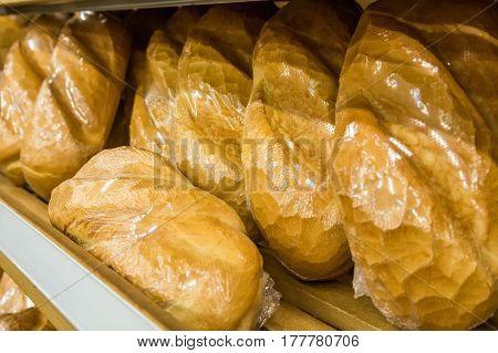 Bread loaves on shelf in grocery store