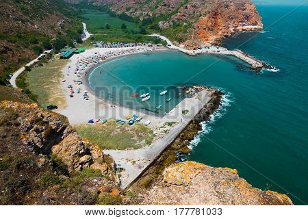 Scenic View of the Bolata bay Bulgaria. Black sea resort dotted with boats and tourists on beach surrounded by hills from birds eye view
